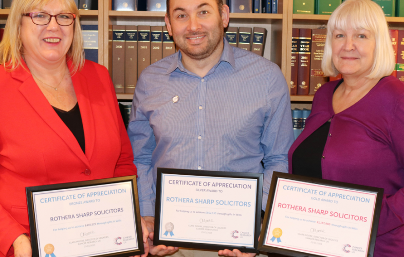 Jayne Smith and Karen Hayward presented with certificates of appreciation for their role in supporting Cancer Research UK