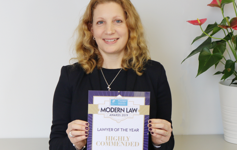 Ann-Marie Bowman collecting award for Modern Law's highly commended 'Lawyer of the Year'